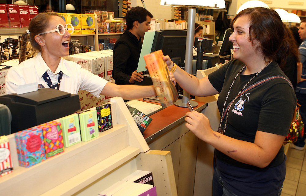 MANHATTAN BEACH, CA - JULY 21: .B&N clerk SEVERINE SEHSUVAROGLU makes the first sale of Harry Potter and the Deathly Hallows to ANNIE ZAVIDOW at the Barnes and Noble in Manhattan Beach, CA. People started lining up around the book store as early as 4pm to be the first to have the newest Harry Potter release.