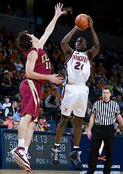 Virginia guard/forward Mamadi Diane (24) shoots over Elon guard Brett James (10).  The Virginia Cavaliers men's basketball team defeated the Elon Phoenix 91-61  at the John Paul Jones Arena in Charlottesville, VA on December 22, 2007.