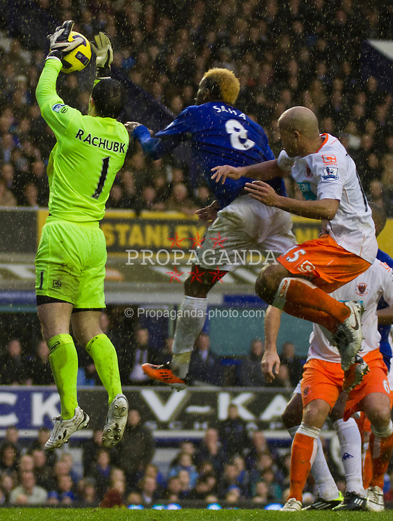 LIVERPOOL, ENGLAND - Saturday, February 5, 2011: Everton's Louis Saha and Blackpool's goalkeeper Paul Rachubka during the Premiership match at Goodison Park (Photo by Vegard Grott/Propaganda).
