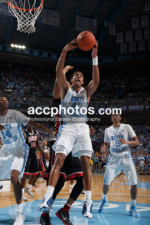 CHAPEL HILL, NC - DECEMBER 29: James Michael McAdoo #43 of the North Carolina Tar Heels rebounds the ball during a game against the UNLV Rebels on December 29, 2012 at the Dean E. Smith Center in Chapel Hill, North Carolina. North Carolina won 73-79. (Photo by Peyton Williams/UNC/Getty Images) *** Local Caption *** James Michael McAdoo