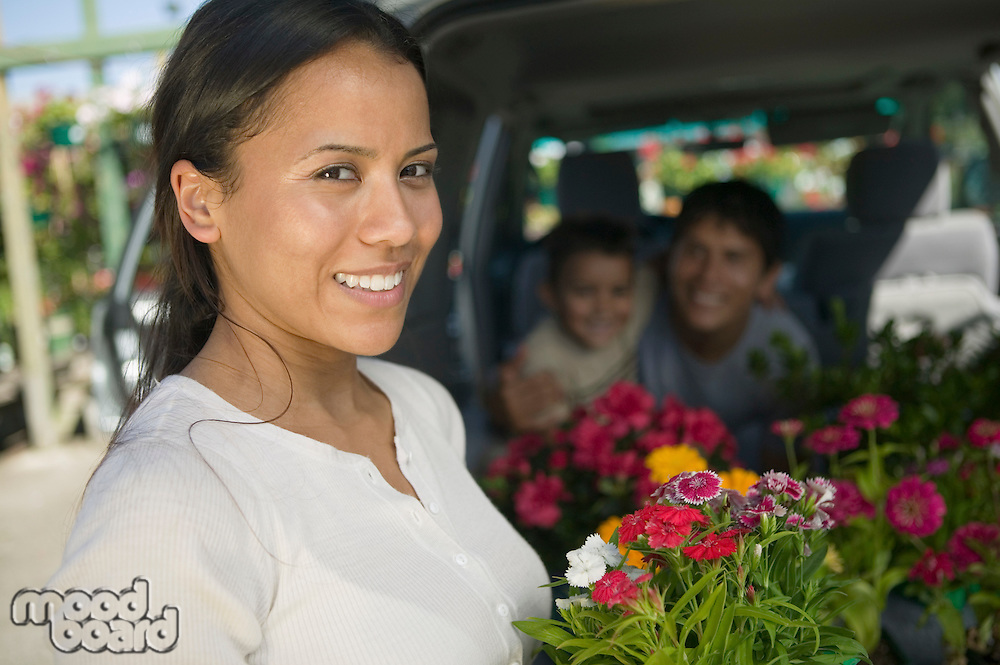 Woman and Family Loading Plants