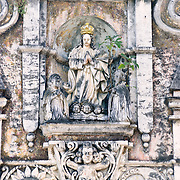 Intricate carvings on the exterior of a partially ruined church in Antigua, Guatemala.