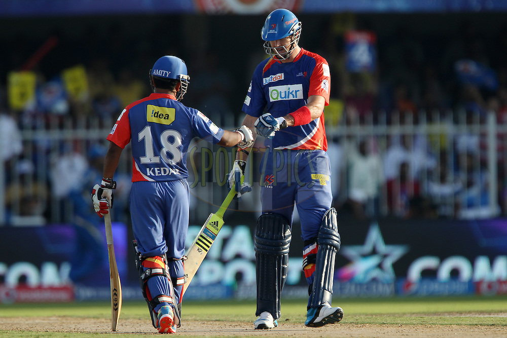 Kedar Jadhav of the Delhi Daredevils and Kevin Pietersen captain of of the Delhi Daredevils during match 16 of the Pepsi Indian Premier League 2014 between the Delhi Daredevils and the Mumbai Indians held at the Sharjah Cricket Stadium, Sharjah, United Arab Emirates on the 27th April 2014<br /> <br /> Photo by Ron Gaunt / IPL / SPORTZPICS