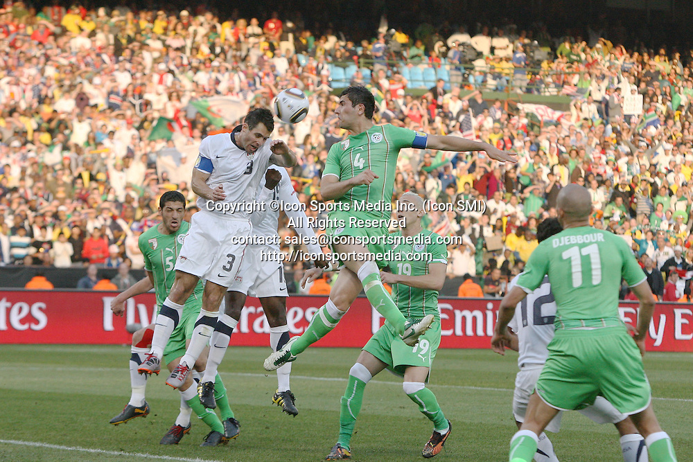 23 JUN 2010: Carlos Bocanegra (USA) (3) and Anther Yahia (ALG) (4). The United States National Team played the Algeria National Team at Loftus Versfeld Stadium in Tshwane/Pretoria, South Africa in a 2010 FIFA World Cup Group C match.