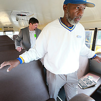 Andy Cantrell, left, and Larry Harmon finsih their inspection of one of the buses at Tupelo Middle School as part of a safety audit the district is conducting.