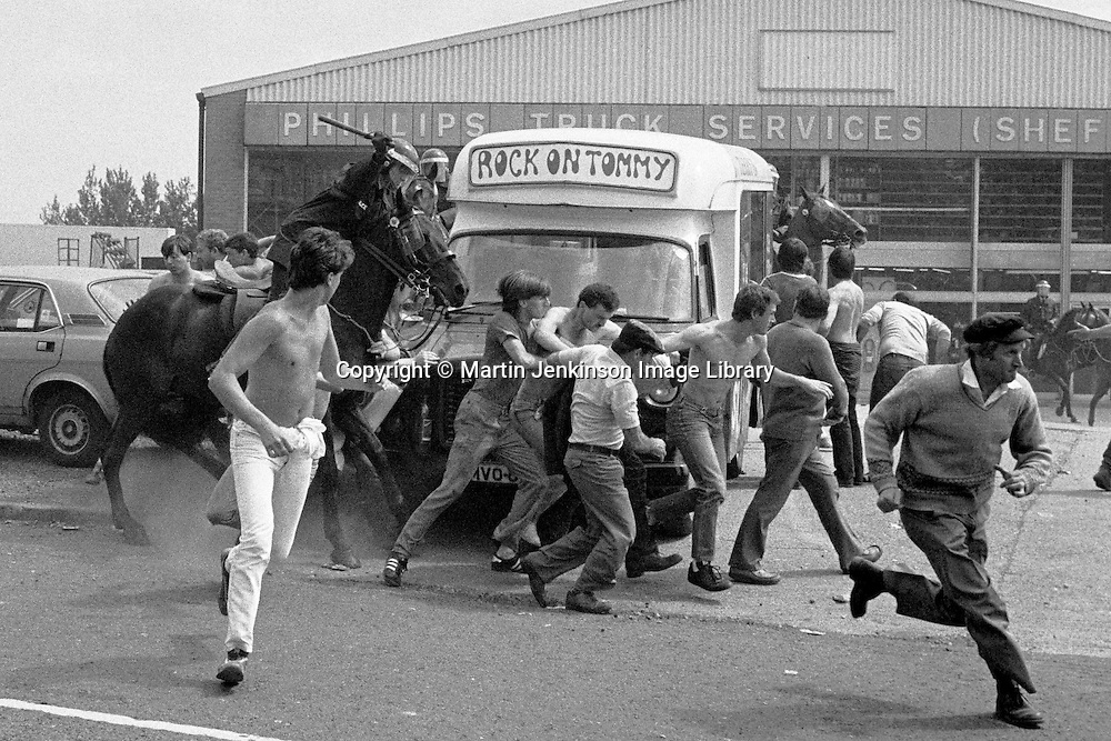 Miners pickets and mounted police at Orgreave during the 1984 strike 18 June 1984. &copy; Martin Jenkinson Image Library<br />