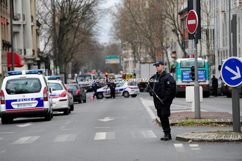 Fusillade Montrouge - 08.01.2015 - Rue de la fusillade / Interpellation Hotel Atlantide  <br />Photo : Dave Winter / Icon Sport<br /><br />At around 07:50 (local time), following a car accident involving grey Renault Clio in the town of Montrouge, a suburb of Paris, a shoot-out ensued during which a police officer and one other person were shot. A 52 year-old man was arrested at the scene, whilst a second escaped, later abandoning his vehicle in the town of Arcueil. At 10:50 it was announced that the police officer, a woman, had died of her injuries whilst a 47 year-old man was still in critical condition. It's still not clear whether there's any link between this shooting and the deadly attack at the office of the Charlie Hebdo magazine the previous day. At approximately 11:30, the BRI (Brigade de recherchŽ et d'intervention- the French equivalent of a SWAT team) secured the Hotel Atlantide on avenue Pierre Brossolette, a hundred or so metres from the scene of the car accident and shooting. A handcuffed man in a red hoodie was seen being led into the hotel, before being lead away some twenty minutes later.