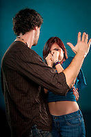 Young man punishing and attacking a young woman.