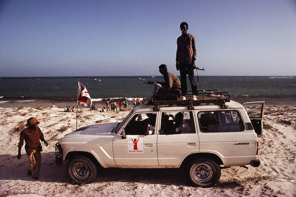 Foreign Aid workers (NGO's) on their day off go to the beach with armed guards.  Mogadishu, war-torn capital of Somalia. March 1992.