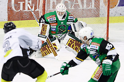 16.12.2012, Hala Tivoli, Ljubljana, SLO, EBEL, HDD Telemach Olimpija Ljubljana vs Dornbirner Eishockey Club, 31. Runde, in picture Olivier Magnan-Grenier (Dornbirner Eishockey Club, #2) shots on Jerry Kuhn (HDD Telemach Olimpija, #35) goal during the Erste Bank Icehockey League 31st Round match between HDD Telemach Olimpija Ljubljana and Dornbirner Eishockey Club at the Hala Tivoli, Ljubljana, Slovenia on 2012/12/16. (Photo By Matic Klansek Velej / Sportida)