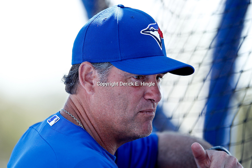March 8, 2011; Dunedin, FL, USA; Toronto Blue Jays manager John Farrell (52) watches batting practice before a spring training game against the New York Yankees at Florida Auto Exchange Stadium. Mandatory Credit: Derick E. Hingle-US PRESSWIRE