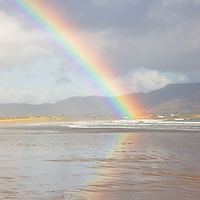 Rainbow Reflexion at Reenroe Beach with view on Cottages of Waterville, Iveragh Peninsula, Ireland / rb021
