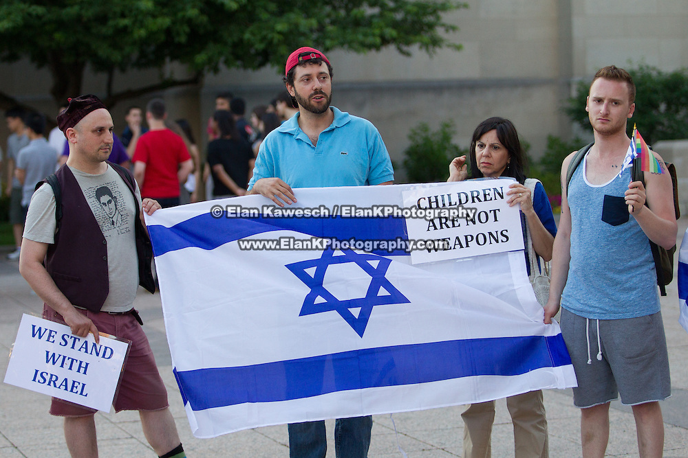 Vigil in memory of three Israeli teenagers, Eyal Yifrach, 19; Gilad Shaar, 16; and Naftali Frankel, 16, who were murdered by Hamas terrorists in June 2014 is held at Boston University's Marsh Plaza on June 30, 2014 in Boston, Massachusetts. (Photo by Elan Kawesch)