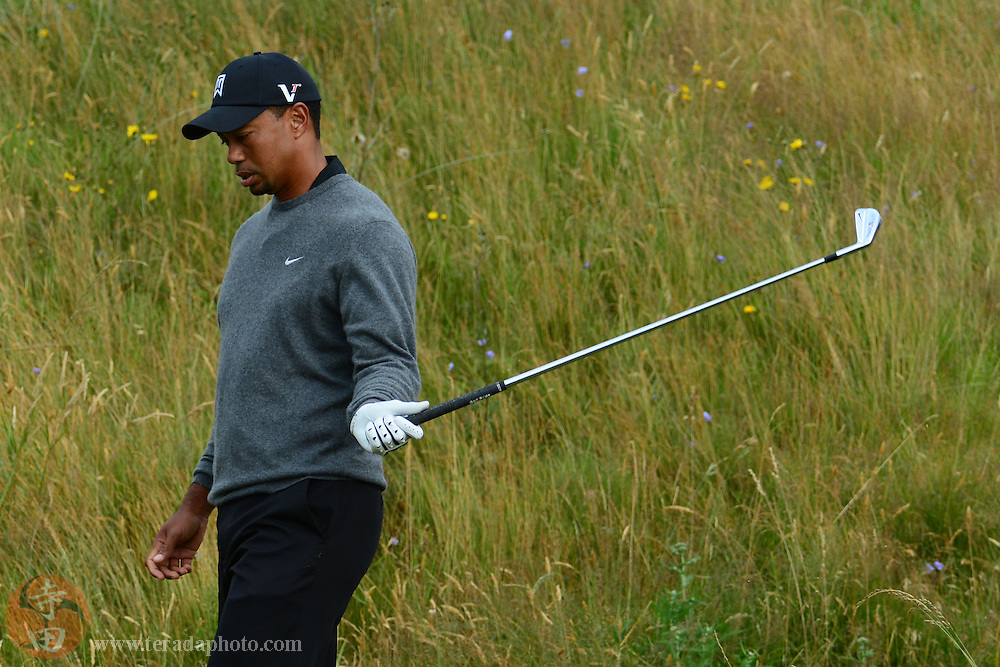 July 20, 2012; St. Annes, ENGLAND; Tiger Woods reacts while walking after his tee shot on the 11th hole during the second round of the 2012 British Open Championship at Royal Lytham & St. Annes Golf Club.