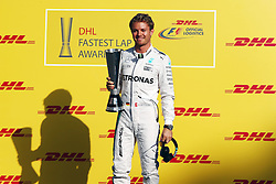 Nico Rosberg (GER) Mercedes AMG F1 presented with the DHL fastest lap award.<br /> 27.11.2016. Formula 1 World Championship, Rd 21, Abu Dhabi Grand Prix, Yas Marina Circuit, Abu Dhabi, Race Day.<br /> Copyright: Batchelor / XPB Images / action press
