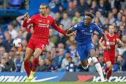 Chelsea forward Tammy Abraham (9) battles for possession with Liverpool defender Joel Matip (32) during the Premier League match between Chelsea and Liverpool at Stamford Bridge, London, England on 22 September 2019.