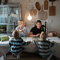 Ben Greenfield his wife Jessa and his family eat dinner together at their home in Spokane, Washington. Photo by Rajah Bose