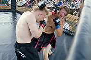 Chris Layten lands a punch to the head of John Onyshko, knocking out his mouth piece, at Yankee Lake Brawlroom 22 on Saturday, April 7, 2010 in Yankee Lake, Ohio.