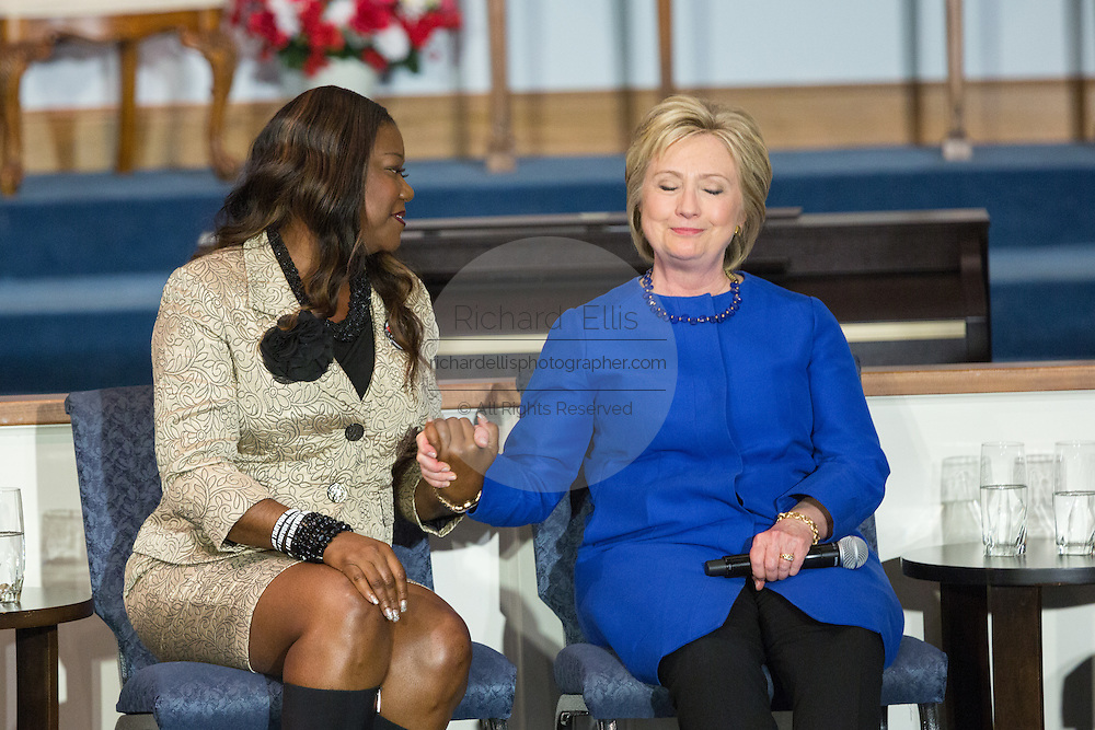 Democratic presidential candidate Hillary Rodham Clinton and Sybrina Fulton, mother of Trayvon Martin share a moment during the Breaking Down Barriers Forum on gun violence at Central Baptist Church February 23, 2016 in Columbia, South Carolina. The event was attended by mothers who lost their children to gun violence and police incidents.