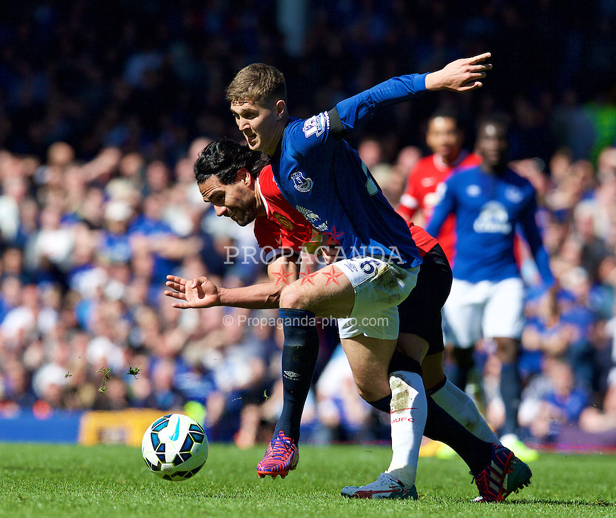 LIVERPOOL, ENGLAND - Sunday, April 26, 2015: Everton's John Stones in action against Manchester United's Radamel Falcao during the Premier League match at Goodison Park. (Pic by David Rawcliffe/Propaganda)
