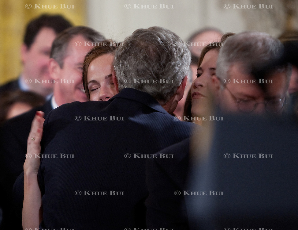 Pres. Bush hugs his daughters Barbara, left, and Jenna after his final address to the nation Thursday, January 15, 2009...Photo by Khue Bui
