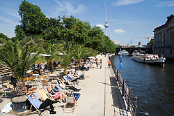Summer riverside cafe beside Spree River in central Berlin Germany 2008