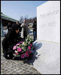 Baroness Warsi lays a wreath during her visit to the Potocari Memorial Centre, Srebrenica, to honour the victims of the Srebrenica Massacre. She reads the names of the victims and along with her parliamentary colleagues she reflects, as part of Project Maja in Bosnia and Herzegovina, Sunday March 4, 2012 . Photo By Andrew Parsons/i-images