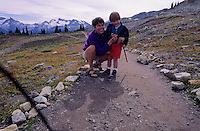 Brett, 3, uses the remote wire control to take a picture of Mom and himself on Whistler Mountain.