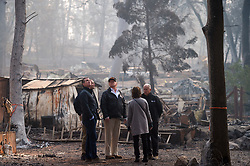 November 17, 2018 - Paradise, California, U.S. - Gov.-elect Gavin Newson, FEMA Director Brock Long, President Donald Trump, Paradise mayor Jody Jones and Gov. Jerry Brown tour the Skyway Villa Mobile Home and RV Park with Gov. Jerry Brown during his visit of the Camp Fire in Paradise, Calif. on Saturday, November 17, 2018. The Camp Fire in Northern California has become the nation's deadliest wildfire in a century and has killed at least 63 people and left more than 1000 still missing. (Credit Image: © Paul Kitagaki Jr./ZUMA Wire)
