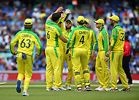 Cricket - 2019 ICC Cricket World Cup - Group Stage: India vs. Australia<br /> <br /> Australia's Nathan Coulter-Nile (6) celebrates taking the wicket of India's Rohit Sharma caught by Alex Carey for 57, at The Kia Oval.<br /> <br /> COLORSPORT/ASHLEY WESTERN