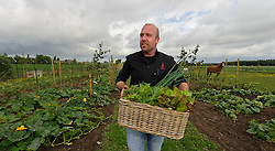 MALDEGEM, BELGIUM - JUNE-18-2011 - Grill master and TV host, Peter De Clercq, makes his daily visit to his farm, just across the street from his restaurant, Elckerlijc, to hand pick fresh produce for the days menu. (Photo © Jock Fistick)