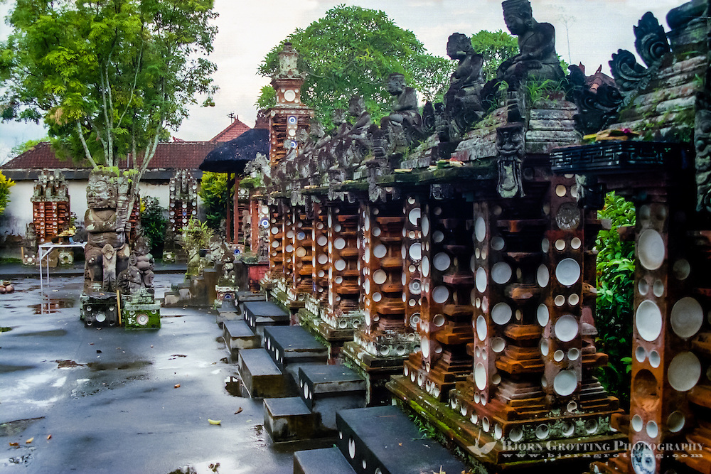 Bali, Tabanan, Kerambitan. One grave for every generation covered with porcelain plates. Puri Agung palace.