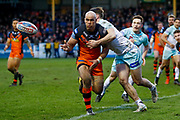 Castleford Tigers centre Jake Webster (3) passes the ball wide during the Betfred Super League match between Castleford Tigers and Widnes Vikings at the Jungle, Castleford, United Kingdom on 11 February 2018. Picture by Simon Davies.