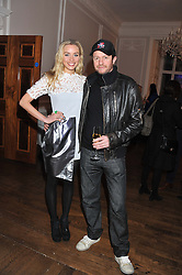 NOELLE RENO and SCOT YOUNG at a champagne reception to launch The Big Egg Hunt presented by Faberge in aid of the charities Action for Children and Elephant Family held at 29 Portland Place, London on 18th January 2012.