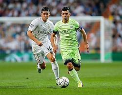 Sergio Aguero of Manchester City is challenged by James Rodriguez of Real Madrid - Mandatory byline: Rogan Thomson/JMP - 04/05/2016 - FOOTBALL - Santiago Bernabeu Stadium - Madrid, Spain - Real Madrid v Manchester City - UEFA Champions League Semi Finals: Second Leg.