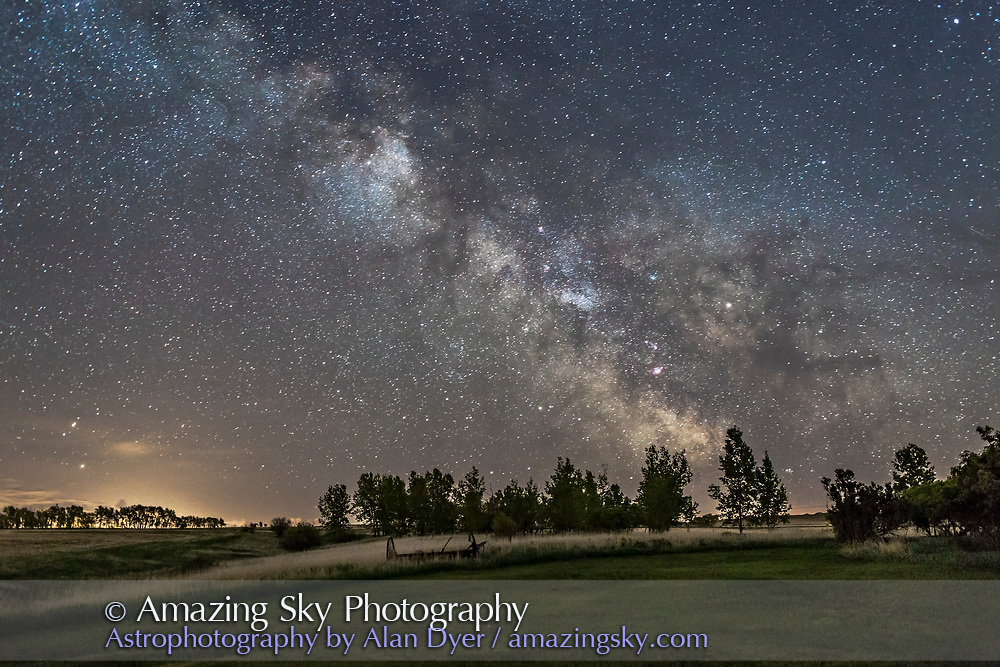 The Milky Way of a late May night, in 2017, with Saturn amid the Milky Way at right, near the dark lanes of the Dark Horse. SHot from home in Alberta (latitude 51&deg; N) as part of a time-lapse sequence testing the Star Adventurer Mini tracker and motion controller. Messier 6 star cluster, one of the most southerly Messier objects is just above the trees at right. The Small Sagittarius Star Cloud (aka M24) and Scutum Star Cloud (above) are the bright patches in the Milky Way. The Lagoon Nebula, M8, is the pink patch below M24.<br /> <br /> This is a single 22-second exposure at f/2.2 and ISO 3200 with the Canon 6D and 35mm lens, one frame from a motion-control panning sequence.