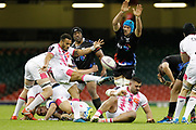 Ospreys flanker Justin Tipuric attempts to charge down Stade Francais scrum half Will Genia' kick during the European Challenge Cup match between Ospreys and Stade Francais at Principality Stadium, Cardiff, Wales on 2 April 2017. Photo by Andrew Lewis.
