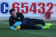Forest Green Rovers goalkeeper James Montgomery warming up during the EFL Sky Bet League 2 match between Mansfield Town and Forest Green Rovers at the One Call Stadium, Mansfield, England on 23 February 2019.