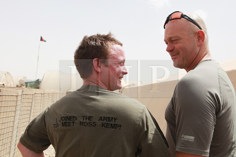 © London News Pictures. 14/06/11. When young Signaller Daniel Gray,  of 21 Signals Regiment  was doing his basic training, one of his mates gave him a T-shirt that said 'I joined the Army to meet Ross Kemp'.  Amazingly, only days after landing in Afghanistan on his first tour, he really has.  Ultimate Force star Ross was in Helmand making a new documentary series and was delighted to be snapped with Mr Gray. Photo credit to read Alison Baskerville/LNP