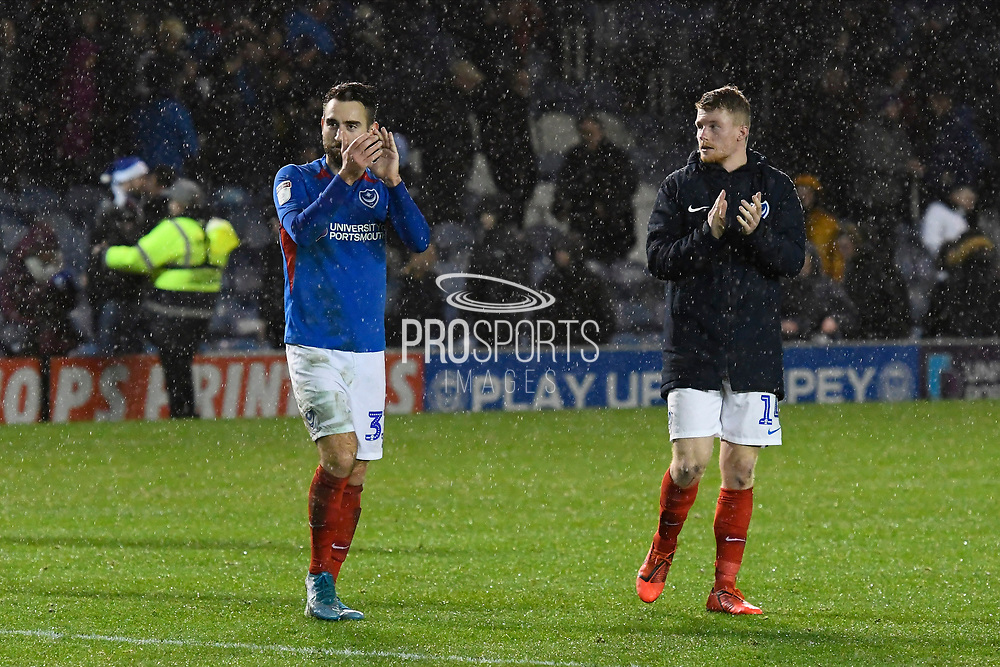 Ben Close (33) of Portsmouth and Andy Cannon (14) of Portsmouth applauds the fans at full time after a 2-0 win during the EFL Sky Bet League 1 match between Portsmouth and Wycombe Wanderers at Fratton Park, Portsmouth, England on 26 December 2019.