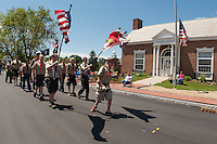 Boy Scout troop 65 march in the Belmont Memorial Day Parade on Monday afternoon followed by a short rededication held at the conclusion of the parade for the War Memorial relocated next to Belmont Library.  (Karen Bobotas/for the Laconia Daily Sun)