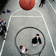 kids shoot hoops in a park in new york. 1998