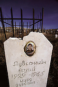 Tombstone with a woman's picture in a graveyard near Ulaanbaatar, Mongolia.
