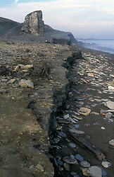 Sea erosion of coal waste on beach below disused mine Seaham Co Durham UK
