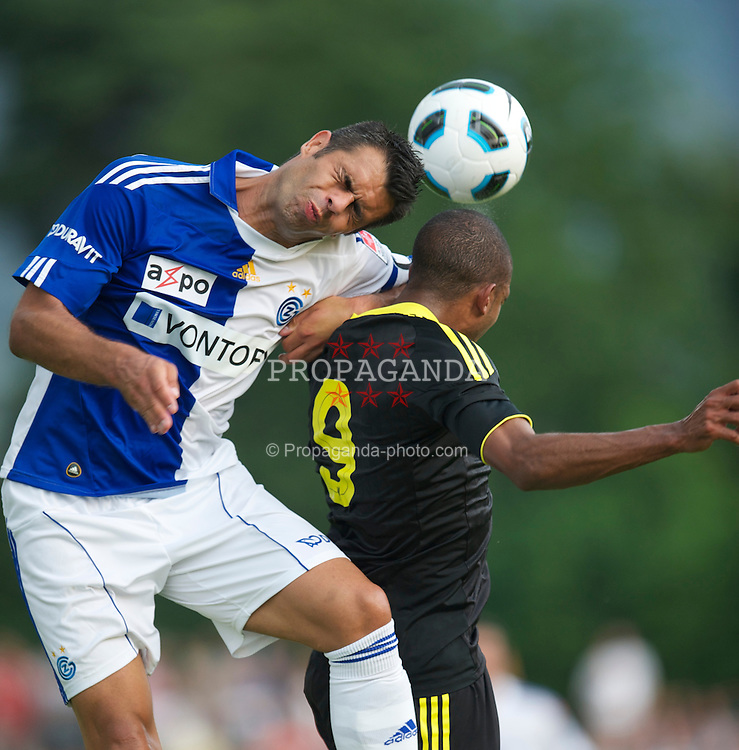 ZUG, SWITZERLAND - Wednesday, July 21, 2010: Liverpool's David Ngog in action against Grasshopper Club Zurich's Guillermo Vallori during the Reds' first preseason match of the 2010/2011 season at the Herti Stadium. (Pic by David Rawcliffe/Propaganda)