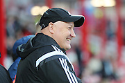 Cardiff City manager, Russell Slade smiling during the Sky Bet Championship match between Brentford and Cardiff City at Griffin Park, London, England on 19 April 2016. Photo by Matthew Redman.