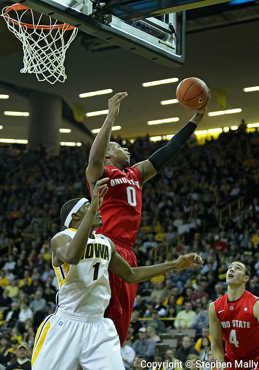 January 04 2010: Ohio State Buckeyes forward Jared Sullinger (0) puts up a shot over Iowa Hawkeyes forward Melsahn Basabe (1) during the first half of an NCAA college basketball game at Carver-Hawkeye Arena in Iowa City, Iowa on January 04, 2010. Ohio State defeated Iowa 73-68.