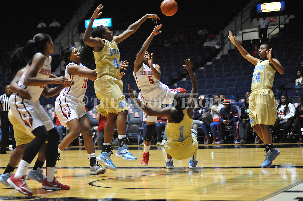 """Ole Miss guard Erika Sisk (5) is fouled by Southern University Jaguars guard Briana Green (1) as Southern University Jaguars guard Cortnei Purnell (40) and Southern University Jaguars guard Micah Garvin (24) defend at the C.M. """"Tad"""" Smith Coliseum in Oxford, Miss. on Thursday, November 20, 2014. (AP Photo/Oxford Eagle, Bruce Newman)"""