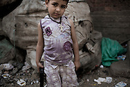 Egypt, Cairo: A young child holds a plastic gun in Moqattam area. ph.Christian Minelli..