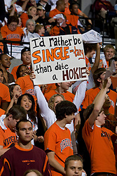 "A UVA fan holds up a sign that reads ""I'd rather by SINGLE-tary than date a Hokie"".  The Virginia Cavaliers men's basketball team faced the Virginia Tech Hokies at the John Paul Jones Arena in Charlottesville, VA on January 16, 2008."